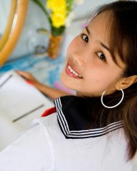 Japanese schoolgirl  lily koh in japanese schoolgirl uniform shows graceful cameltoe. Lily Koh in Japanese schoolgirl uniform shows elegant cameltoe