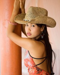 Thai cowgirl nn  nice asian teen in cowboy hat slides down skimpy panties. Cute Asian teen in cowboy hat slides down skimpy panties